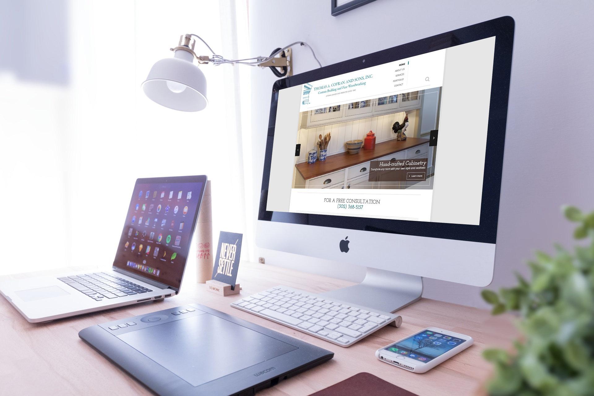 desktop computer displaying Cofran and Sons website