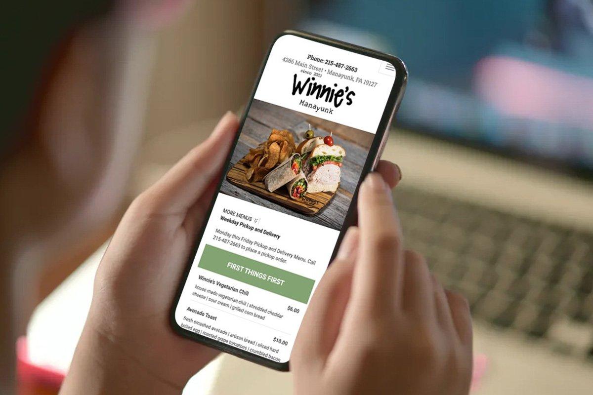 Blue Blaze custom website shown on a phone for Winnie's in Philadelphia